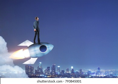 Businessman standing on launching rocket on abstract city background with copy space. Start up and success concept