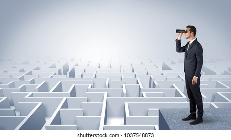 Businessman standing on maze and looking forward to the future concept