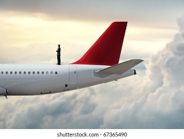 Businessman standing on a plane