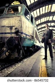 Businessman standing on a platform beside a train