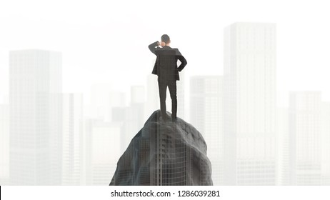 Businessman standing on rock and looking at the city