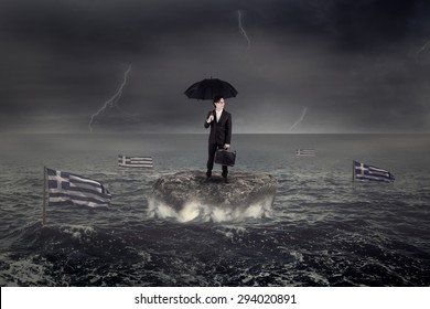 Businessman standing on the rock under umbrella with Greece flag sink on the sea. Concept of Greece economic crisis