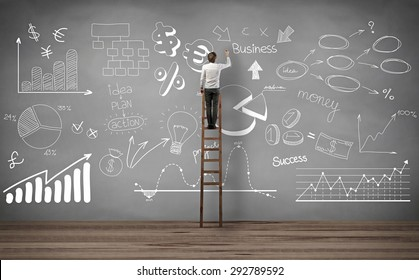 businessman standing on the stairs and writing business project