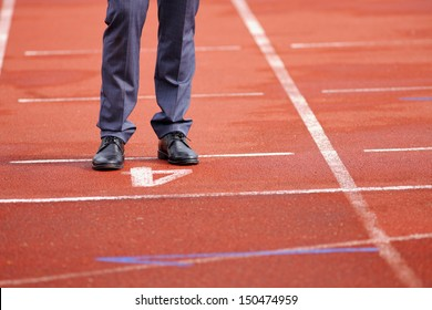 Businessman standing on the start line close up of shoes