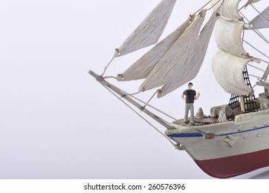Businessman standing on top of the sailing ship