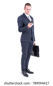 Businessman standing on white background and looking to smartphone, People with Business Concept, isolated on white background.