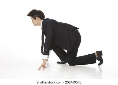 Businessman standing on white wallpaper