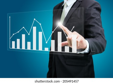 Businessman standing posture achievement hand touch graph finance isolated on over blue background