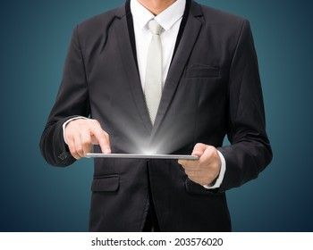 Businessman standing posture hand hold graph on tablet isolated on dark background