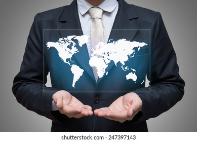 Businessman standing posture hand holding world map isolated on gray background
