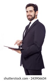 Businessman standing with a tablet computer, isolated on a white background