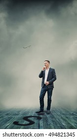 Businessman Standing and Thinking About Future Business Plans?
