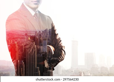 businessman standing and thinking on buildings backgrounds, double exposure