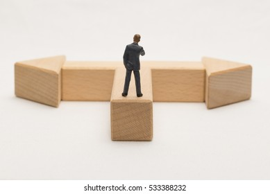 Businessman standing at a turning point