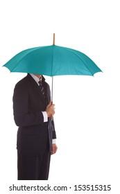 Businessman standing under umbrella.