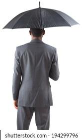 Businessman standing under umbrella on white background