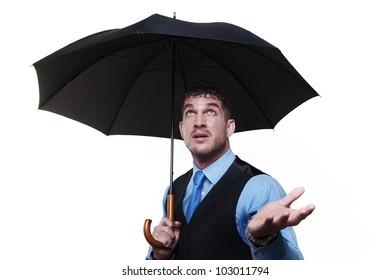 businessman standing under a umbrella shot in the studio