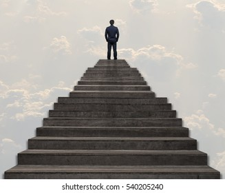 Businessman standing for walking up stairs over the cloud and sky background,Success business and Ambitions concept