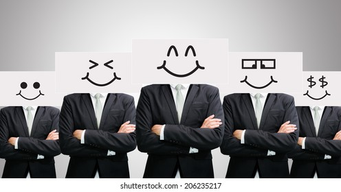 Businessman standing white paper happy smile face holding front of head on gray background