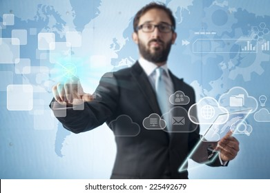 Businessman standing and working with touch screen technology