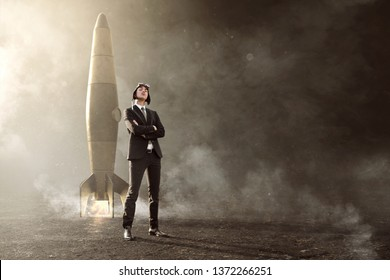 Businessman stands in front of his rocket