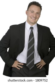 A Businessman stands with his hands by his side isolated on a white background.