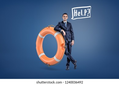 A businessman stands leaning on a large orange life buoy with a speech bubble holding a word Help inside. Offering assistance. Business consulting. Help for your company.