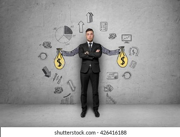 Businessman stands over background with painted hands holding money bags surrounded by economic and statistical graphs. Passive income and profits. Srategic calculation and research. Business idea