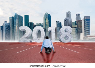 businessman at starting points waiting for the start in running track with text 2018 year, Start to new year 2018, new year concept