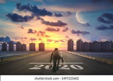 Businessman starting road to success 2020. Elements of this image furnished by NASA.
