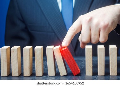 Businessman starts the process of falling dominoes. Correction of errors malfunctions. Implementation of plans. Starting work after stopping. Continuation working, obstacle avoidance. Maintainability.