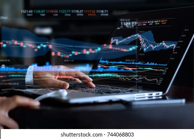 Businessman with statistic graph of stock market financial indices analysis on laptop screen, finance data and technology concept