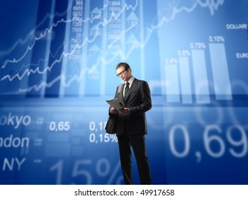 Businessman with statistics and schemes on the background