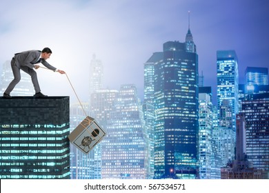 Businessman stealing safe from building