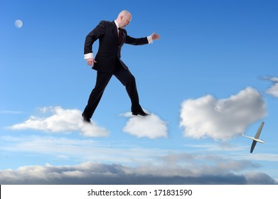 a businessman stepping on clouds