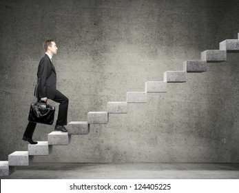 Businessman stepping up a staircase