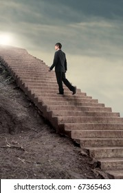 Businessman stepping up to a stairway