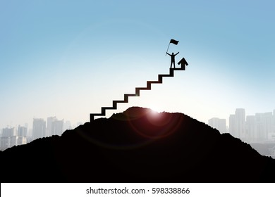 Businessman stepping up a stairway, Success concept