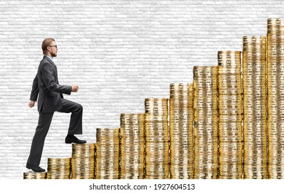 Businessman steps up stairs made of gold coins ( money ), on white background. Path, moving towards success concept