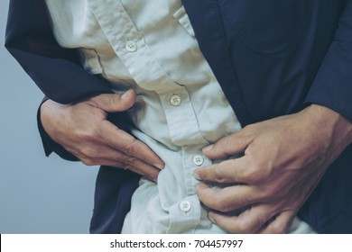 Businessman stomachache selective focus