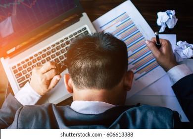 Businessman strain on earnings.