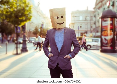 businessman in the street with the bag on a head