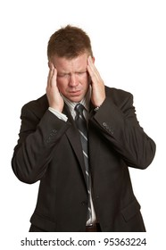 Businessman with stress pain headache holding head