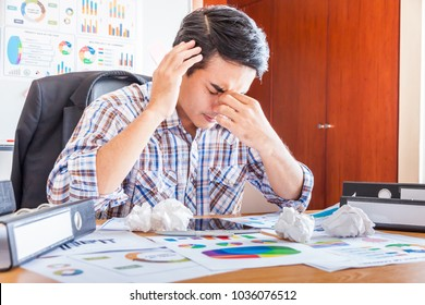 businessman stress at work, personal working with laptop in the office, Sad, tired or depressed businessman at the desk.