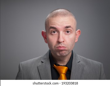 Businessman stressed in a studio portrait isolated on dark background