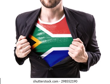 Businessman stretching suit with South African Flag isolated on white