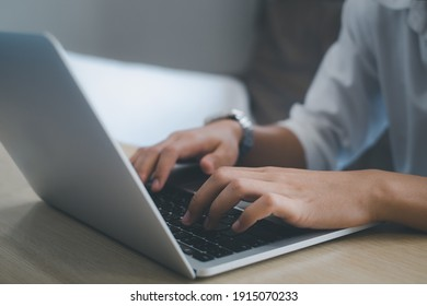 Businessman or student wearing white shirt using laptop for searching, working, online learning, marketing, studying, distance education network online technology background.selective focus.