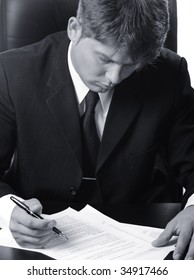 The businessman the studying contract before the signature. Monochrome photo.