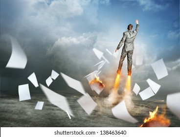 Businessman Success. A businessman launching upwards, paperwork flying everywhere!