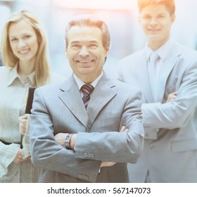 businessman and successful business team at the office looking  the camera  smiling